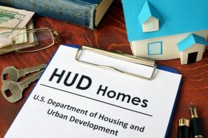 hud homes written on clipboard