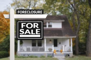 foreclosure with for sale sign